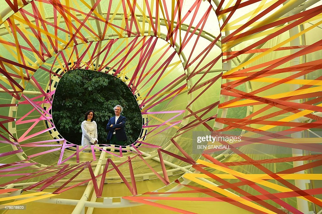 Spanish architects Lucia Cano and Jose Selgas pose by their Serpentine pavilion structure at the Serpentine Gallery in London on June 22 2015 For the...