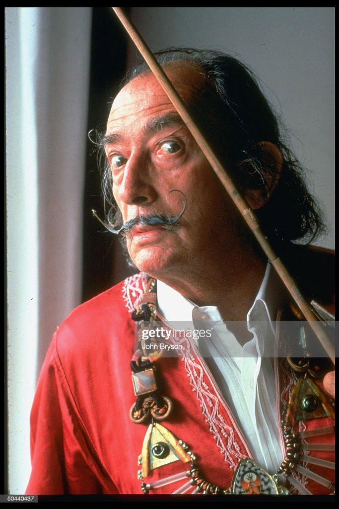 Spanish artist Salvador Dali near window.
