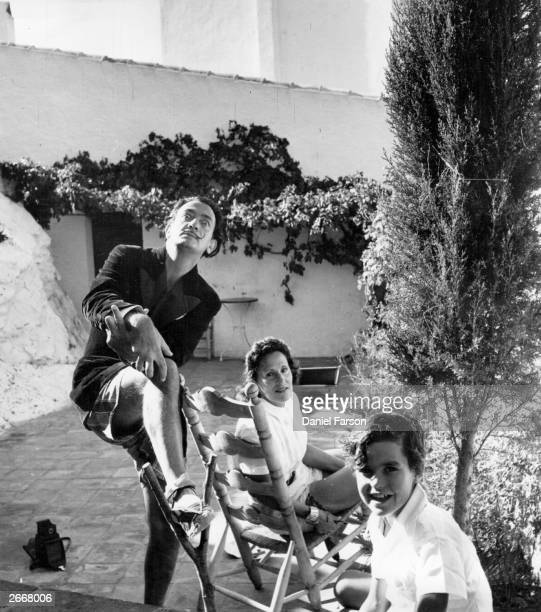 Spanish artist Salvador Dali with his wife Gala and a child at his villa at Port Lligat Original Publication Picture Post 5587 We Visit Dali pub 1951