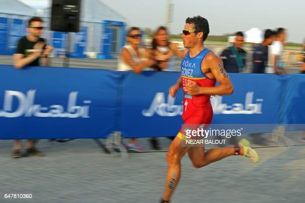 Spanish athlete Javier Gomez Noya of Spain competes in the ITU World Triathlon at the Yas Marina Circuit in Abu Dhabi on March 4 2017 / AFP PHOTO /...