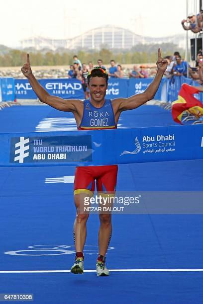 Spanish athlete Javier Gomez Noya of Spain reacts after wining the ITU World Triathlon at the Yas Marina Circuit in Abu Dhabi on March 4 2017 / AFP...