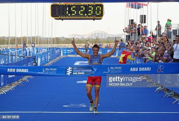 Spanish athlete Javier Gomez Noya of Spain reacts upon winning in the ITU World Triathlon at the Yas Marina Circuit in Abu Dhabi on March 4 2017 /...