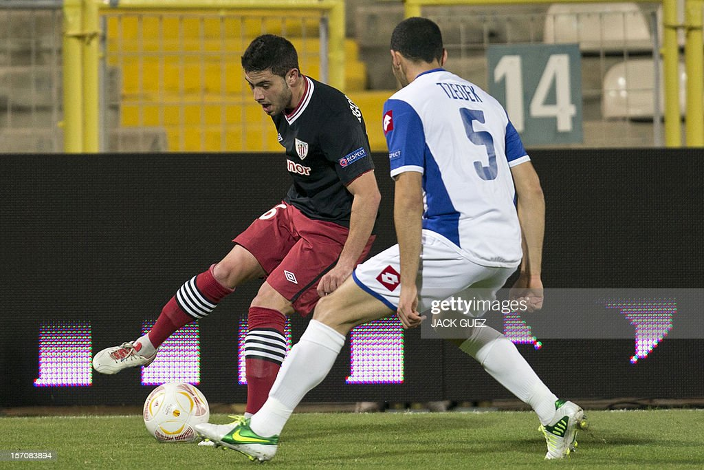 Spanish Athletic Club's defender Mikel San Jose (L) is challenged by Israeli Hapoel Kiryat Shmona's defender Shir Tzedek (R) during their UEFA Europa League Group I qualifying football match at the Kiryat Eliezer Stadium, in the Mediterranean coastal city of Haifa ,on November 28, 2012.