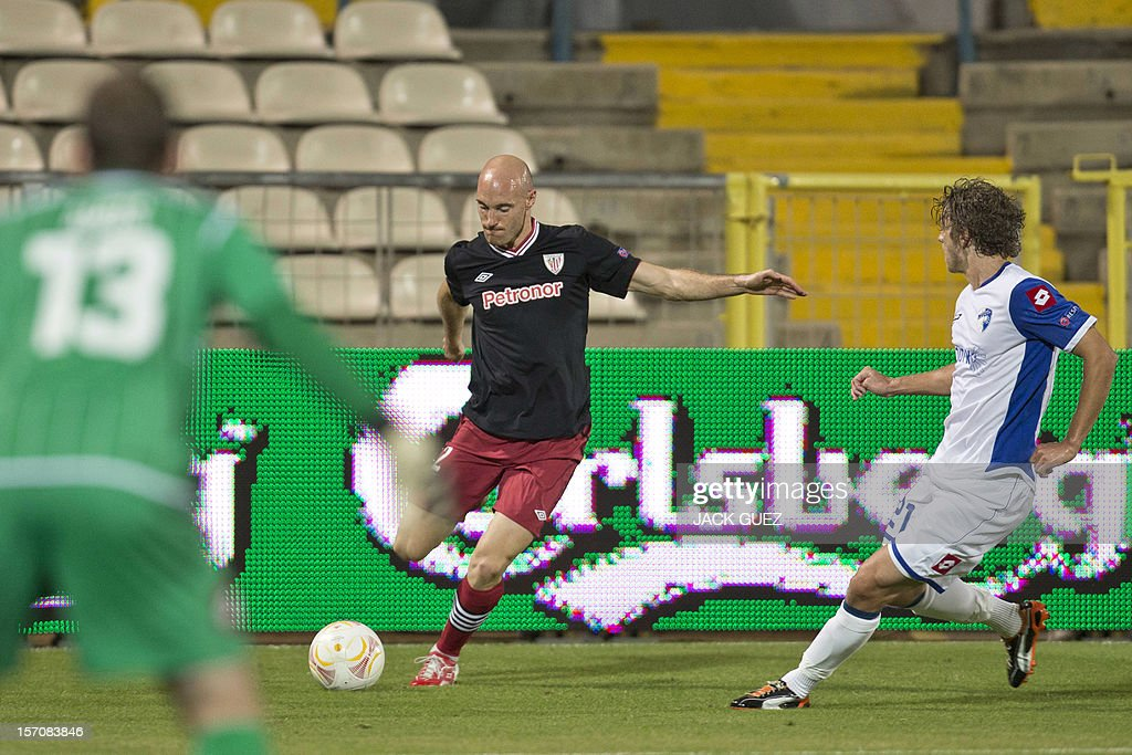 Spanish Athletic Club's forward Gaizka Toquero (C) is challenged by Israeli Hapoel Kiryat Shmona's midfielder Roni Porokara (R) during their UEFA Europa League Group I qualifying football match at the Kiryat Eliezer Stadium in the Mediterranean coastal city of Haifa, on November 28, 2012.