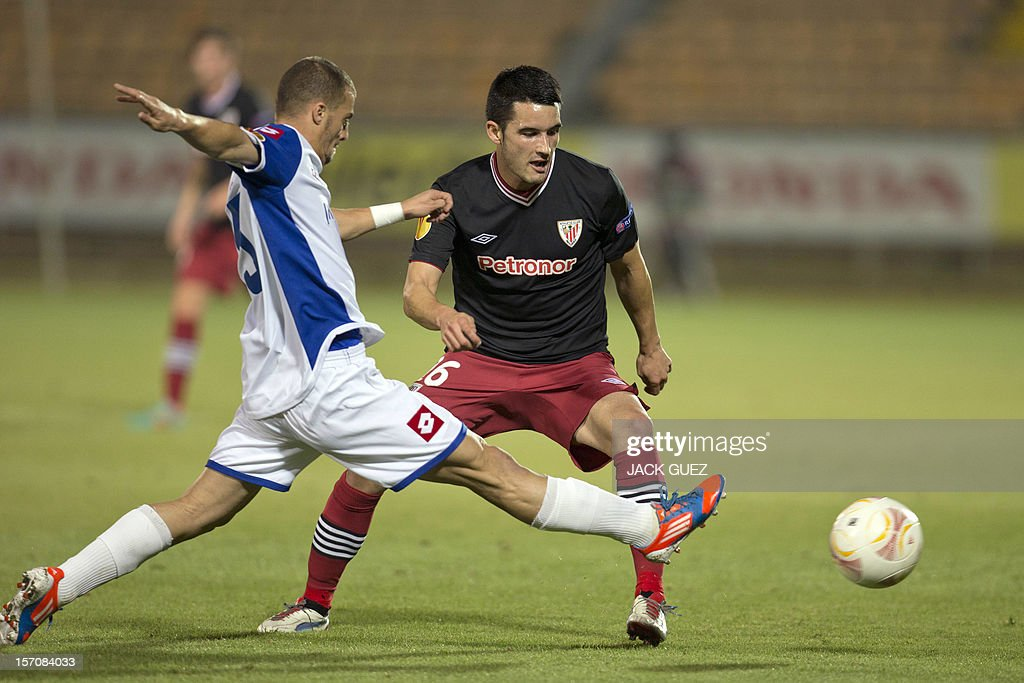 Spanish Athletic Club's forward Ismael Lopez (R) is challenged by Israeli Hapoel Kiryat Shmona's defender Mekonent Yazo (L) during their UEFA Europa League Group I qualifying football match at the Kiryat Eliezer Stadium, in the Mediterranean coastal city of Haifa, on November 28, 2012.