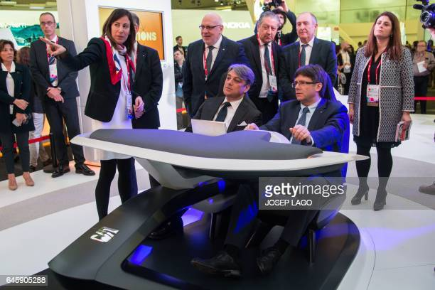 Spanish automobile manufacturer Seat's president Luca de Meo and President of the Catalan regional Government Carles Puigdemont test a Seat car...