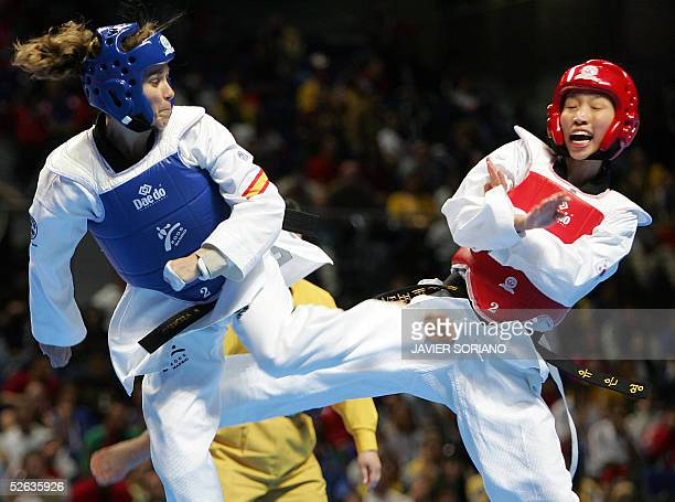 Spanish Belen Asensio fights against Korean Yu EunYoung during their women's under 47 kg final match at the Taekwondo World Championships in Madrid...