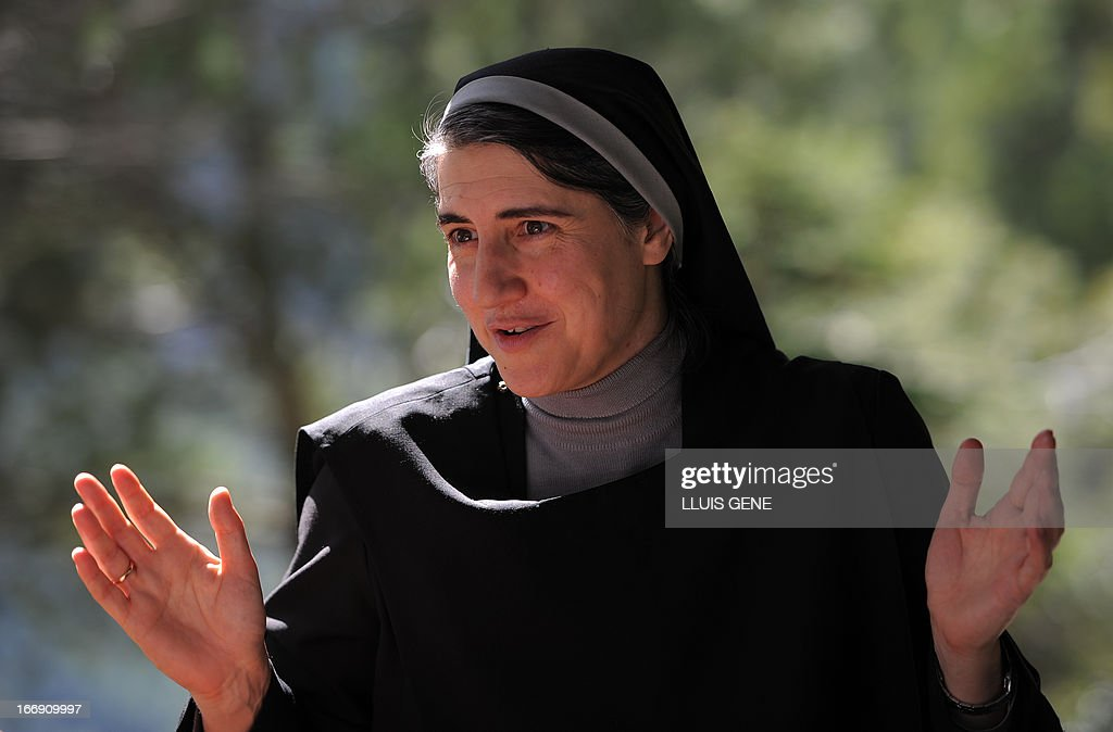 Spanish Benedictine nun Teresa Forcades gestures during an interview with AFP at the Monasterio de St. Benet in Montserrat on April 17, 2013. Forcades studied medecine, theology and religious matters. From her small convent in the mountains near Barcelona, Sister Teresa Forcades, a Harvard-educated Catalan nun, has emerged as a leading advocate of the arguments of Spain's 'indignant' protest movement against the excesses of capitalism. Decked in a black habit, Forcades criticised the austerity measures, which include cuts to spending on health care and education, which Spain's conservative government has put in pace to rein in the public deficit during an interview with AFP.