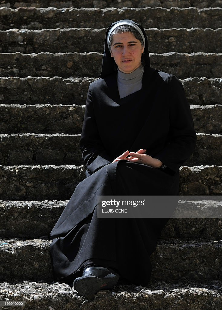 Spanish Benedictine nun Teresa Forcades poses during an interview with AFP at the Monasterio de St. Benet in Montserrat on April 17, 2013. Forcades studied medecine, theology and religious matters. From her small convent in the mountains near Barcelona, Sister Teresa Forcades, a Harvard-educated Catalan nun, has emerged as a leading advocate of the arguments of Spain's 'indignant' protest movement against the excesses of capitalism. Decked in a black habit, Forcades criticised the austerity measures, which include cuts to spending on health care and education, which Spain's conservative government has put in pace to rein in the public deficit during an interview with AFP.