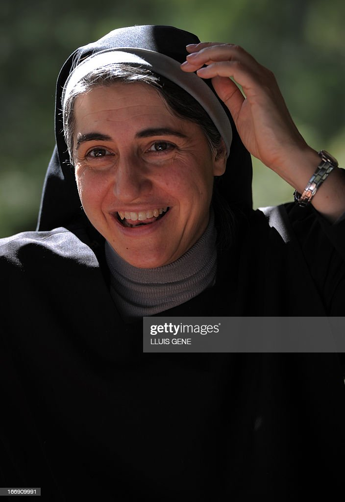 Spanish Benedictine nun Teresa Forcades smiles during an interview with AFP at the Monasterio de St. Benet en Montserrat in April 17, 2013. Forcades studied medecine, theology and religious matters. From her small convent in the mountains near Barcelona, Sister Teresa Forcades, a Harvard-educated Catalan nun, has emerged as a leading advocate of the arguments of Spain's 'indignant' protest movement against the excesses of capitalism. Decked in a black habit, Forcades criticised the austerity measures, which include cuts to spending on health care and education, which Spain's conservative government has put in pace to rein in the public deficit during an interview with AFP. AFP PHOTO/ LLUIS GENE