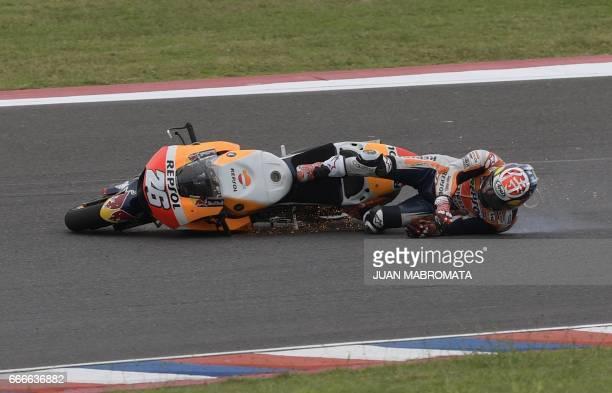 Spanish biker Dani Pedrosa falls from his Honda during the MotoGP race of the Argentina Grand Prix at Termas de Rio Hondo circuit in Santiago del...