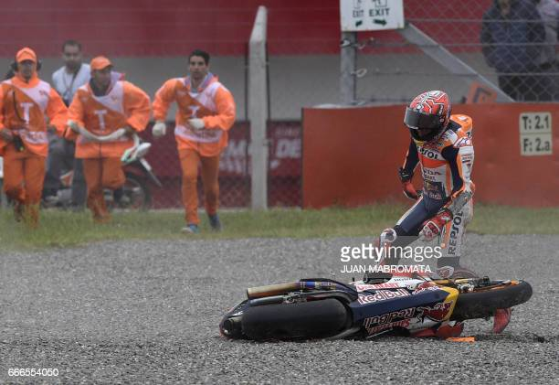 Spanish biker Marc Marquez stands next to his Honda after falling during the MotoGP race of the Argentina Grand Prix at Termas de Rio Hondo circuit...