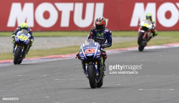 Spanish biker Maverick Vinales on Yamaha celebrates upon winning the MotoGP race of the Argentina Grand Prix at Termas de Rio Hondo circuit in...