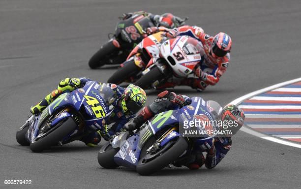 TOPSHOT Spanish biker Maverick Vinales rides his Yamaha next to Italian Valentino Rossi during the MotoGP race of the Argentina Grand Prix at Termas...