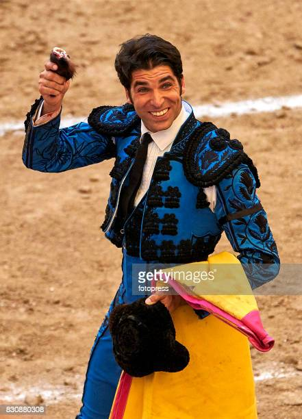 Spanish bullfighter Cayetano Rivera Ordonez shows the bull's ear after the bullfighting as part of the La Peregrina Festival at Plaza de Pontevedra...