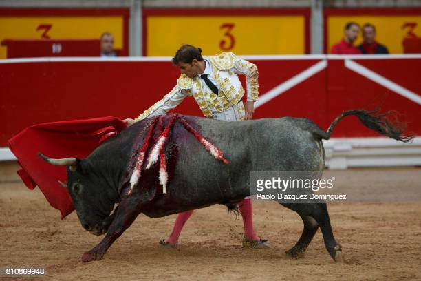Spanish bullfighter Eugenio de Mora performs with a bull from Jose Escolar Gil's fighting bulls during a bullfight on the third day of the San Fermin...