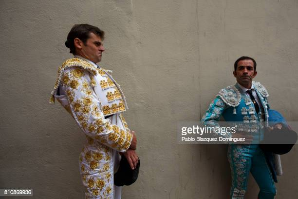 Spanish bullfighter Eugenio de Mora prepares to perform on a bullfight with Jose Escolar Gil's fighting bulls on the third day of the San Fermin...