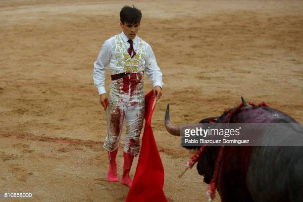 Spanish bullfighter Gonzalo Caballero perfoms to kill a bull from Jose Escolar Gil's fighting bulls after he was tossed to the ground during a...
