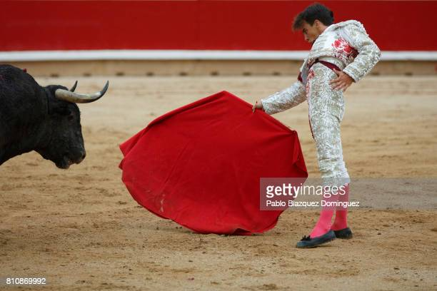 Spanish bullfighter Gonzalo Caballero performs with a bull from Jose Escolar Gil's fighting bulls during a bullfight on the third day of the San...