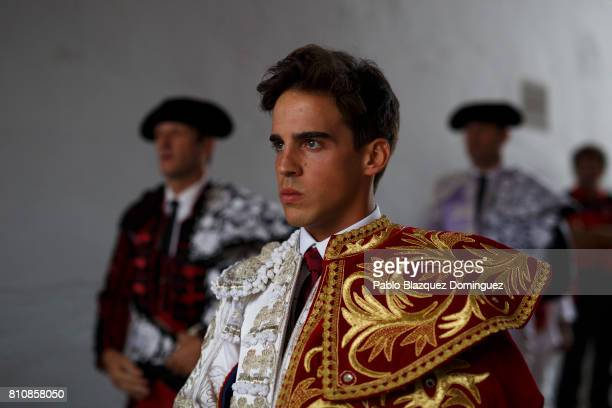 Spanish bullfighter Gonzalo Caballero prepares to perform during a bullfight with Jose Escolar Gil's fighting bulls on the third day of the San...