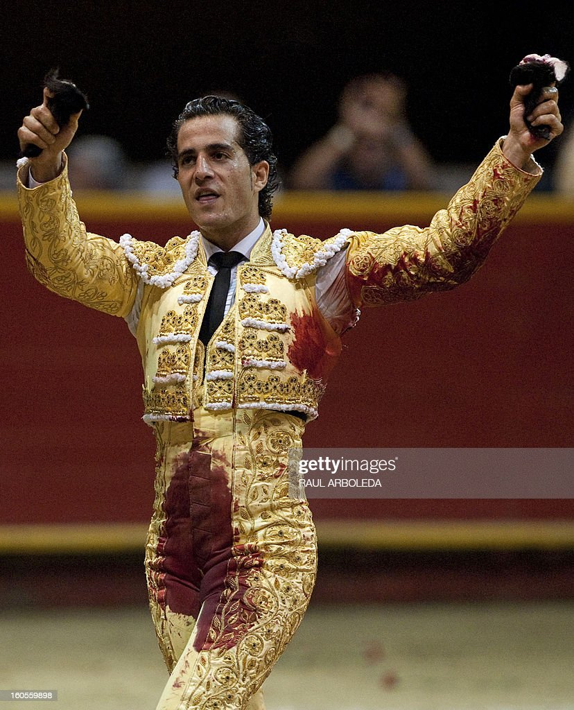 Spanish bullfighter Ivan Fandino celebrates raising the bull's ears after a bullfight at La Macarena bullring on February 2, 2013 in Medellin, Antioquia deparment, Colombia. AFP PHOTO/Raul ARBOLEDA
