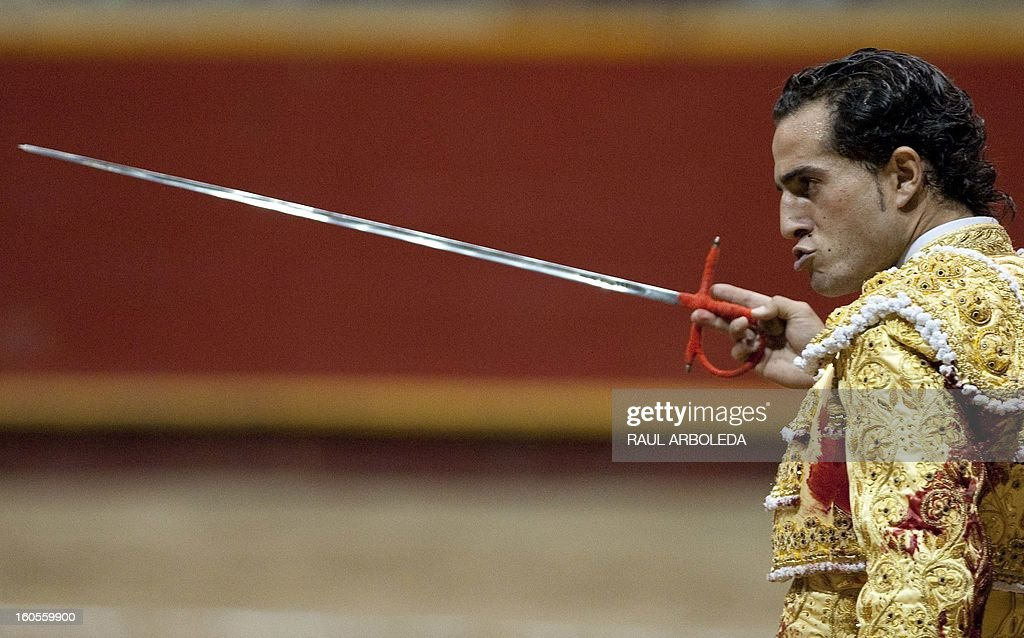 Spanish bullfighter Ivan Fandino performs during a bullfight at La Macarena bullring on February 2, 2013 in Medellin, Antioquia deparment, Colombia. AFP PHOTO/Raul ARBOLEDA
