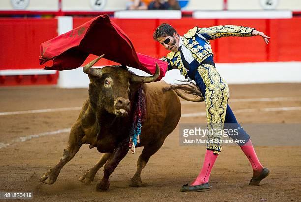 Spanish bullfighter Juan Jose Padilla performs during a bullfighting as part of the Feria Santiago in a bullfight on July 24 2015 in Santander Spain