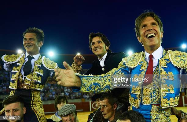 Spanish bullfighter Julio Benitez Diego Ventura and Manuel Diaz 'El Cordobes' celebrates after cut more than two bull ears on March 11 2017 in Moron...