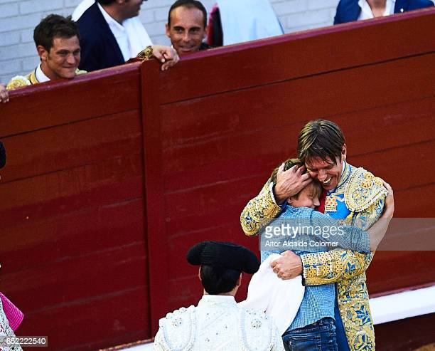 Spanish bullfighter Manuel Diaz 'El Cordobes' celebrates with his son during the Bullfight between Julio Benitez and Manuel Diaz 'El Cordobes' on...