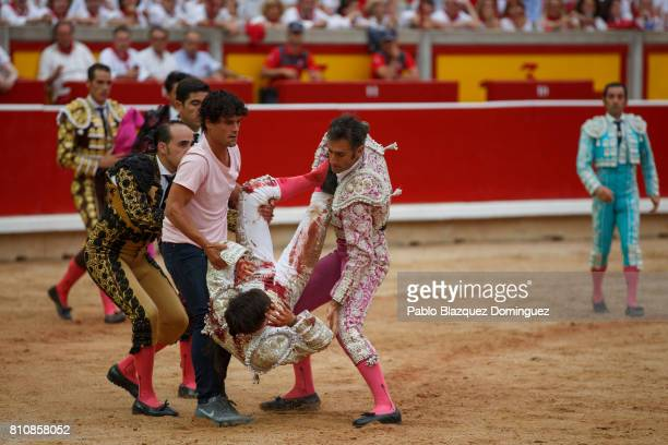 Spanish bullfighter Miguel Abellan and other bullfighters carry Spanish bullfighter Gonzalo Caballero after he was tossed by a bull from Jose Escolar...