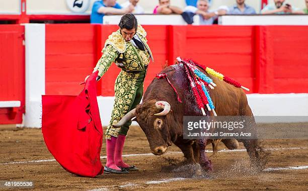 Spanish bullfighter Morante de la Puebla performs during a bullfighting as part of the Feria Santiago in a bullfight on July 25 2015 in Santander...