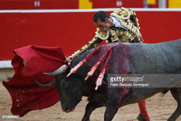 Spanish bullfighter Pepe Moral performs with a bull from Jose Escolar Gil's fighting bulls during a bullfight on the third day of the San Fermin...
