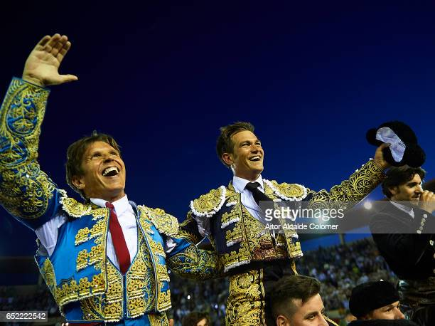 Spanish bullfighters Julio Benitez and Manuel Diaz 'El Cordobes' celebrates after cut more than two bull ears during the Bullfight between Julio...