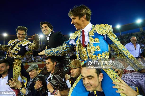 Spanish bullfighters Julio Benitez Diego Ventura and Manuel Diaz 'El Cordobes' celebrates after cut more than two bull ears during the Bullfight...