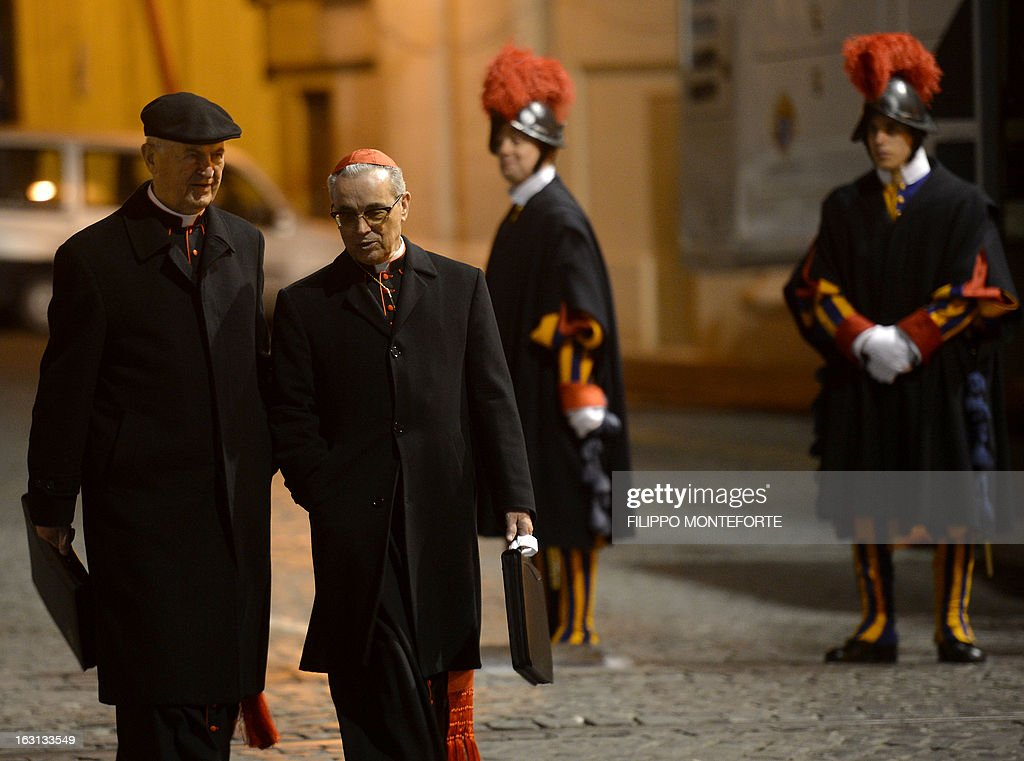 Spanish cardinal Santos Abril y Castello (R) walks after a meeting of a conclave to elect a new pope on March 4, 2013 at the Vatican. The Vatican meetings will set the date for the start of the conclave this month and help identify candidates among the cardinals to be the next leader of the world's 1.2 billion Catholics. AFP PHOTO/ Filippo MONTEFORTE