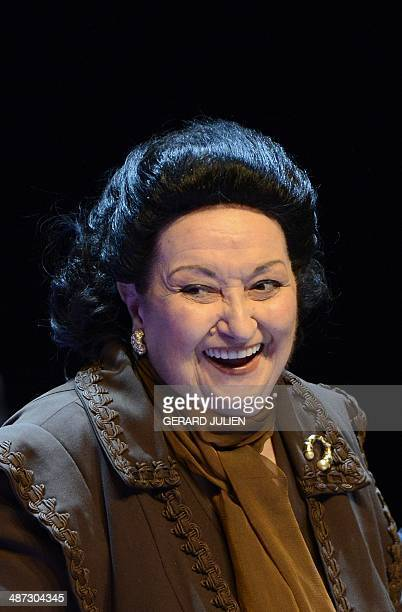 Spanish Catalan opera soprano Montserrat Caballe laughs after being awarded the International medal for Arts on November 18 2013 in Madrid during the...
