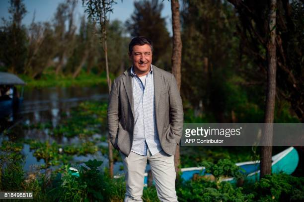 Spanish chef Joan Roca poses for pictures during a symposium on biodiversity and gastronomy amid the floating gardens of Xochimilco a UNESCO World...
