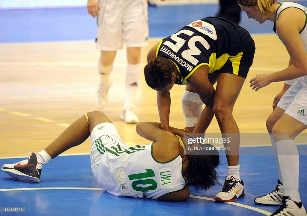 Spanish Cindy Lima (L) of Hungarian Hat-Agro UNI Gyorfights for the ball with US Angel McCoughtry (35) of the Turkish Fenerbahce Istanbul in Gyor on February 22, 2013 during their Euro League match.