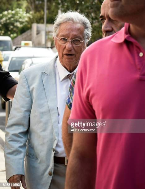 Spanish Civil Guard plainclothes policemen escort Spanish Football Federation vice president Juan Padron outside the Football Federation building in...