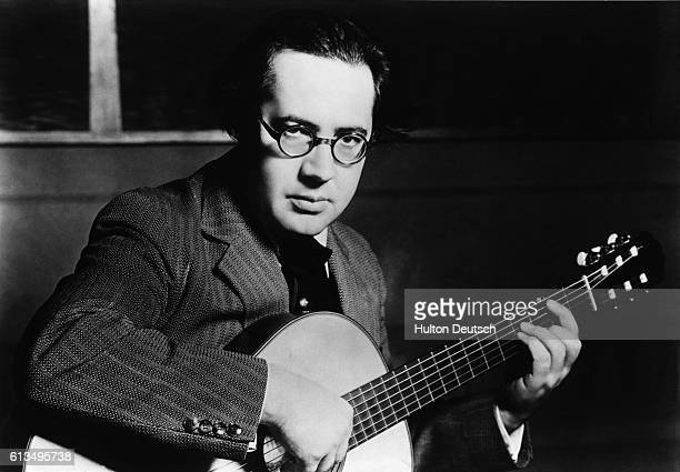 Spanish classical guitarist Andres Segovia performs