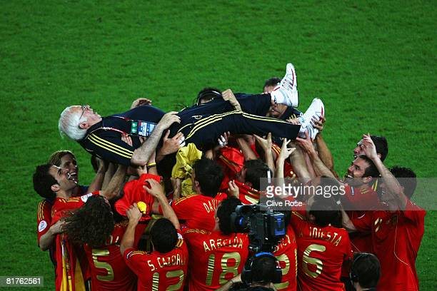 Spanish coach Luis Aragones is lifted by Spanish players following Spain's victory over Germany in the UEFA EURO 2008 Final match between Germany and...