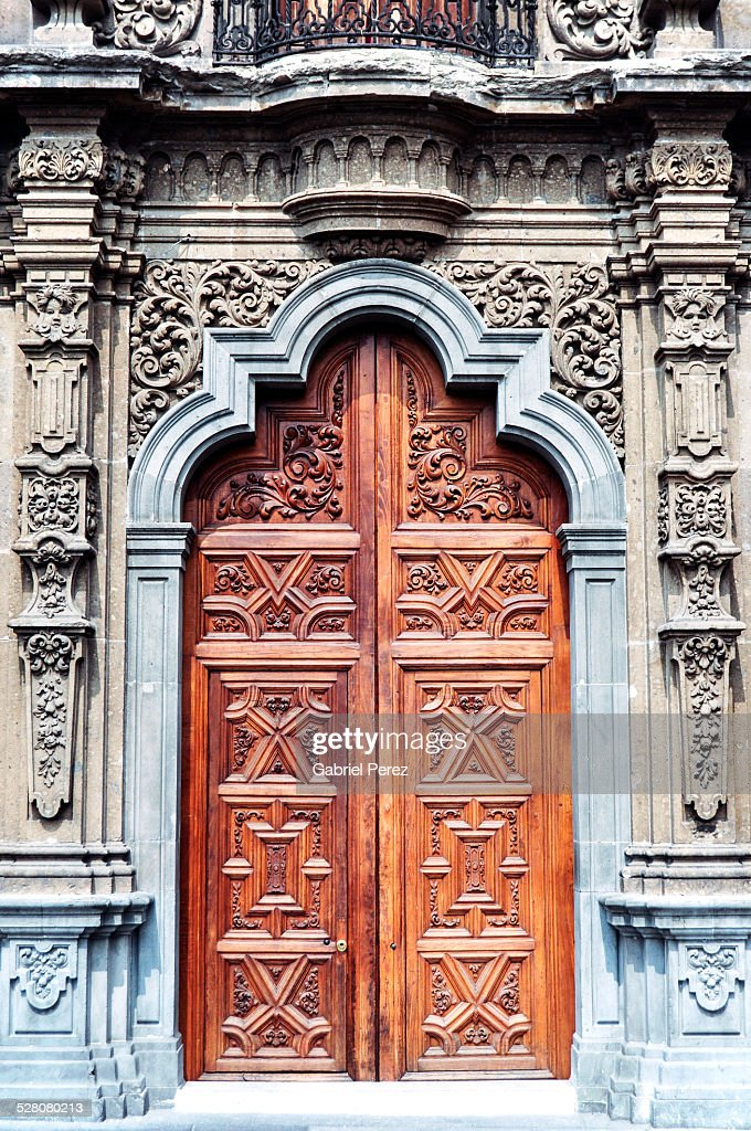 A spanish colonial door in mexico city stock photo getty for Door in spanish