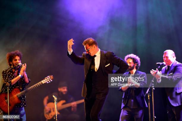 Spanish comedian duo 'Los Morancos' members Jorge Cadaval and Cesar Cadaval perform with Spanish flamenco singer Nany Cortes and Spanish flamenco...