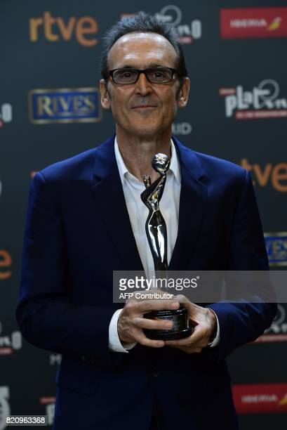 Spanish composer Alberto Iglesias poses with the Platino award to Best Original Score during the 4th edition of the 'Premios Platino' for...