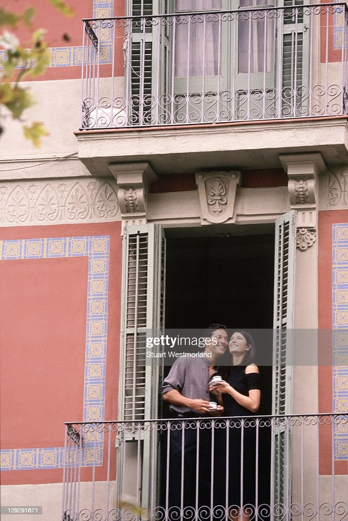 Spanish couple on balcony spain stock photo getty images for Balcony in spanish