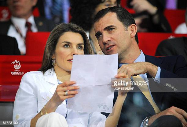 Spanish Crown Prince Felipe and his wife Princess Letizia read the match sheet as they attend the Euro 2008 championships semifinal football match...