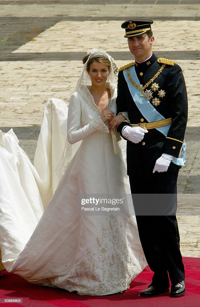 Spanish Crown Prince Felipe de Bourbon and his bride, Princess Letizia Ortiz pose for a picture in the court yard of the royal palace after their wedding ceremony at the Almudena cathedral May 22, 2004 in Madrid.