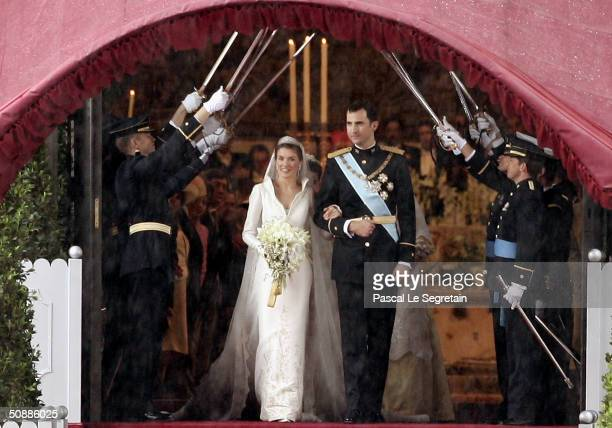 Spanish Crown Prince Felipe de Bourbon and his bride Princess Letizia Ortiz pose for a picture after their wedding ceremony at the Almudena cathedral...