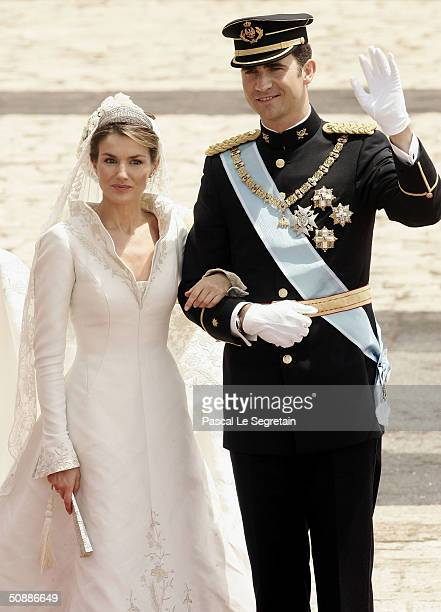 Spanish Crown Prince Felipe de Bourbon and his bride Princess Letizia Ortiz pose for a picture in the court yard of the royal palace after their...