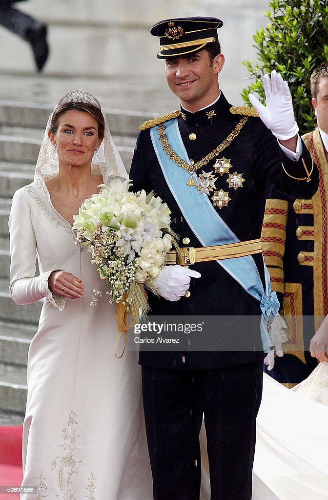 Spanish Crown Prince Felipe de Bourbon and his bride, princess Letizia Ortiz leave the Almudena cathedral after their wedding ceremony May 22, 2004 in Madrid.